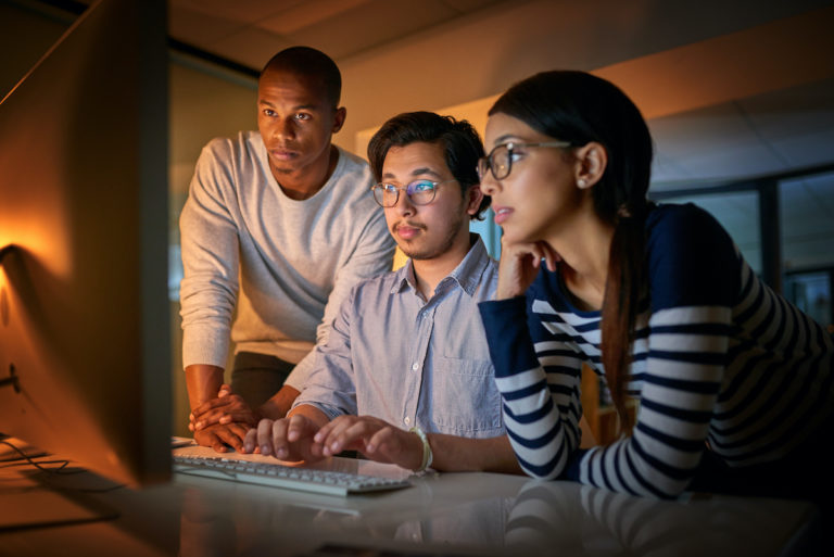 Shot of computer programmers working together